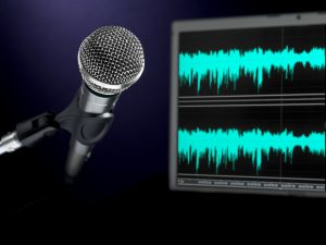 A dynamic microphone and a waveform monitor.